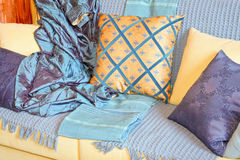 Blanket and pillows. Bunch of pillows and blankets over sofa Stock Photos