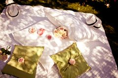 Blanket and pillows decorated with roses Royalty Free Stock Photography