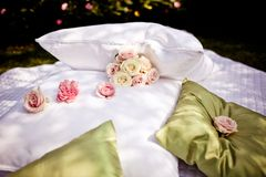 Blanket and pillows decorated with roses Stock Photo