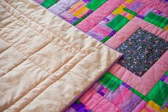 Blanket sewed manually from pieces of a fabric 3030. Royalty Free Stock Photos