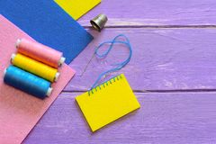 Basic blanket stitch. How to do a basic blanket stitch. Wool or synthetic felt sewing for kids. Colourful felt sheets, thread set. Blanket stitch. Blanket stitch Royalty Free Stock Photo