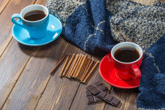 Blanket and two cups of coffee on wooden floor Royalty Free Stock Photos