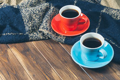 Blanket and two cups of coffee on wooden floor Stock Image