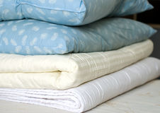 Blankets and feather pillows Stock Photos