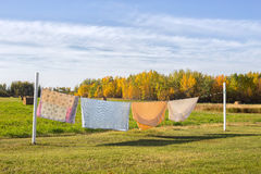 Blankets hanging on clothesline Stock Photos
