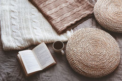 Blankets, ottomans and reading Stock Images