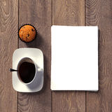 Blanks with cup of coffee on a wooden texture Stock Photography