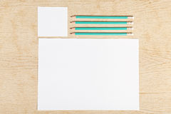 Blanks of empty paper with pencils. Royalty Free Stock Photo
