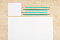 Blanks of empty paper with pencils. Stock Photos