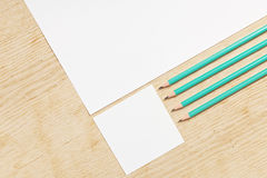 Blanks of empty paper with pencils. Royalty Free Stock Photography