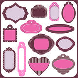 Blanks and tabs tags. Blank set of tags and icons for scrapbooking in pink flowers and polka dots Stock Photos