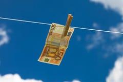 Blanqueo de dinero. Imagen de archivo libre de regalías