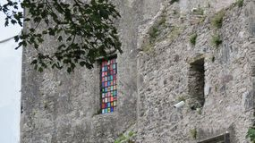 Blarney Castle and a Colorful Stained Glass Window. Blarney Castle in County Cork, Ireland. A historic medieval castle built in 1446. Travel in Europe. A royalty free stock photography