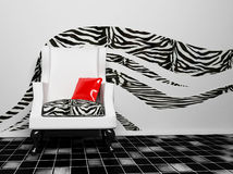 A blask and white armchair with a red pillow. African interior, rendering Stock Photo