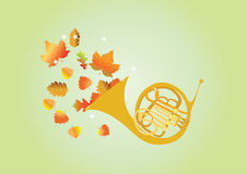 A blast of Autumn. A french horn blowing out autumn leaves Stock Photography
