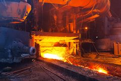 Blast furnace. Close view of working blast furnace at the metallurgical plant royalty free stock photo