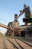Blast furnace and railway. Metallurgical furnace in the iron refine factory Royalty Free Stock Photos