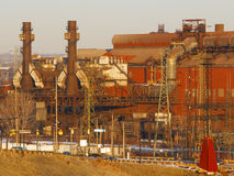 Blast furnaces. Old steel mill with blast furnaces in late afternoon sunlight royalty free stock photography