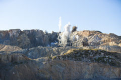 Blast in open cast mining quarry Royalty Free Stock Photography
