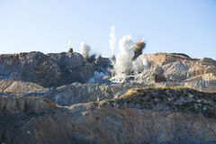 Blast in open cast mining quarry Royalty Free Stock Images