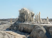 Blast in open oit. Blast of limestone in open cast mining quarry Stock Image