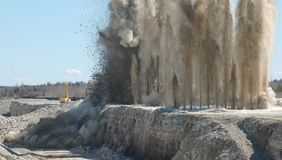 Blast in open pit Royalty Free Stock Photo