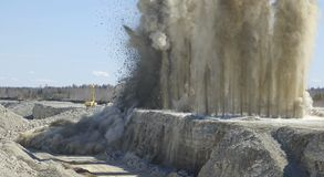 Blast in open pit. Blast in open cast mining quarry Royalty Free Stock Photography