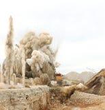 Blast in open pit. Blast of limestone in open cast mining quarry Royalty Free Stock Photo