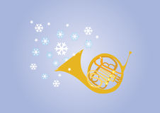 A blast of winter. A french horn blows winter snowflakes into the crisp cold air Stock Image