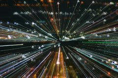 Blast zoom effect , light lines with long exposure. Light lines with long exposure, speed motion abstract background in the dark night , blast zoom effect , zoom stock photography