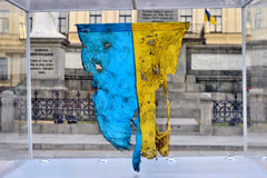 Blasted in the battle flag of Ukraine. Scorched and riddled battle flag of Ukraine. when sent to the front was given to recruit a friend and together they went Stock Image