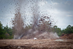 Blasting limestone in a quarry.GN. Blasting limestone rock so it can be excavated for the limstone industry.GN royalty free stock image