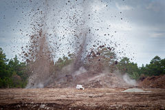 Blasting limestone in a quarry.GN. Blasting limestone rock so it can be excavated for the limstone industry.GN stock image