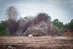 Blasting limestone in a quarry.GN Royalty Free Stock Image