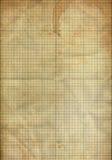 Blatt des faltenden Papiers des Diagramms befleckte durch Kaffee Stockbilder