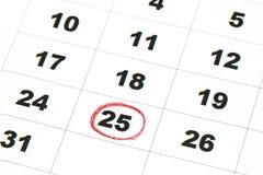 Blatt des Wandkalenders mit rote Markierung am 25 Lizenzfreie Stockfotografie