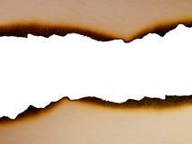 Blatt Papier mit den versengten Rändern nah oben Lizenzfreie Stockbilder