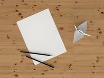 Blatt Papier und Origami Lizenzfreie Stockbilder
