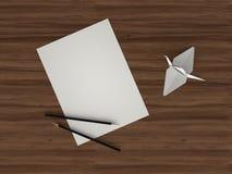 Blatt Papier und Origami Stockfotografie