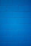 Blau farbiger Ziegelsteinhintergrund Stockfotos