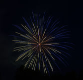 Blau-Gelb-orange Feuerwerke Stockfotos