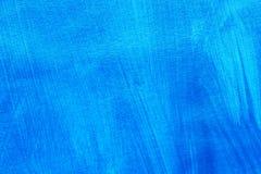 Blau gemalte Hintergrundbeschaffenheit Stockfotos