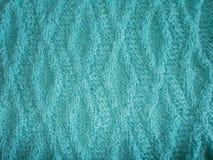 Blau gestrickte Beschaffenheit mit einem Rautenmuster Lizenzfreie Stockfotos
