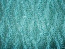 Blau gestrickte Beschaffenheit mit einem Rautenmuster Stockfoto