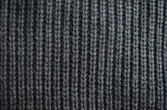 Blau gestrickter Strickjackenhintergrund Stockfotografie