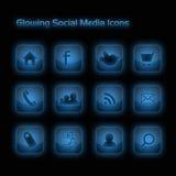 Blau-glühende Sozialmedia-Ikonen Stockfotos