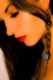 Blau-goldener Ohrring Stockfotos