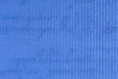 Blau prägeartiger Plastikbeschaffenheitshintergrund, Abschluss oben Lizenzfreie Stockfotos
