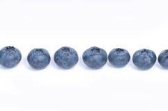 Blaubeeren auf weißem Hintergrund Lizenzfreie Stockfotos