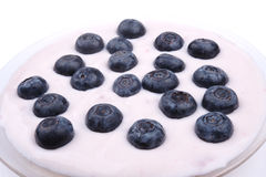 Blaubeeren mit Joghurt Lizenzfreie Stockbilder